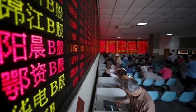 Здравствуй кризис!: На Шанхайской бирже приостановили торги из-за резкого падения акций