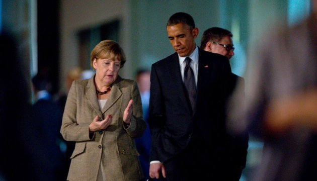 Obama and Merkel urge implementation of Minsk peace deal