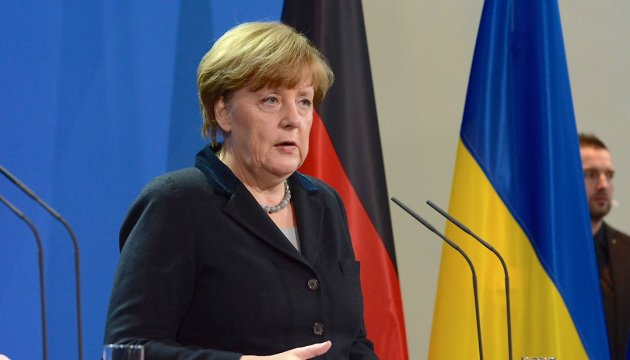 Merkel thanks Yatsenyuk for his contribution to reform process