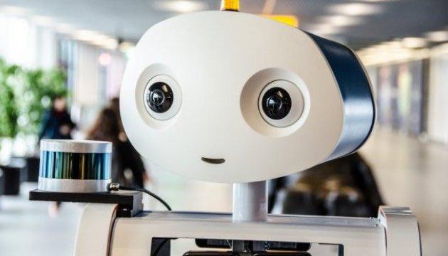 Робот Spencer супроводжує пасажирів в аеропорту Схіпхол