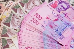 Нацбанк послабив курс гривні до 27,76