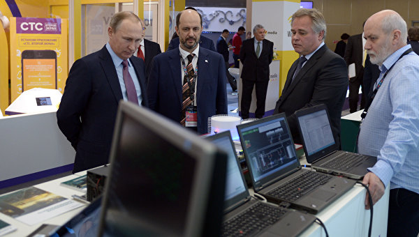 На фото: президент Росії Володимир Путін, директор компанії