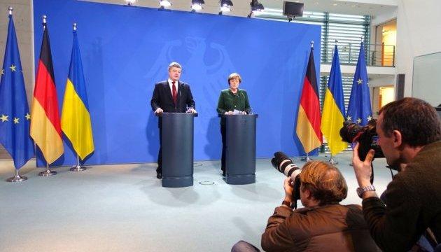 Порошенко и Меркель попытаются найти совместные подходы к