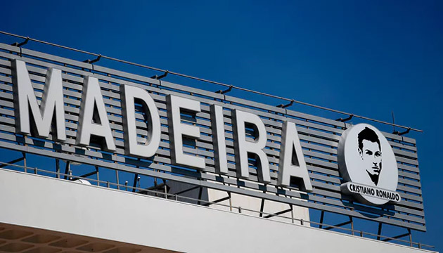 The Madeira airport sign flanked by a portrait of Cristiano Ronaldo. Photograph: Francisco Leong/AFP/Getty Images