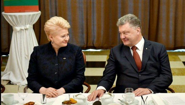 Грибаускайте: Мы будем защищать права украинских работников в Литве