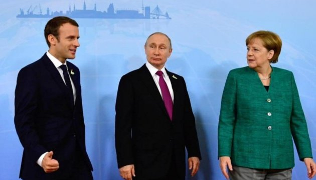 Merkel, Macron and Putin call for ceasefire in Donbas