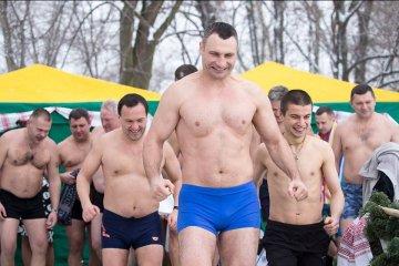 Kyiv city mayor Vitali Klitschko dives into water to celebrate Orthodox Epiphany. Photos