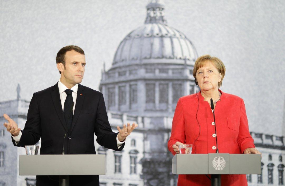 Президент Франції Еммануель Макрон та канцлер ФРН Ангела Меркель