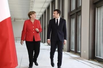 Macron et Merkel saluent l'échange de prisonniers