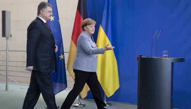 Präsident Poroschenko kündigt Besuch von Angela Merkel an