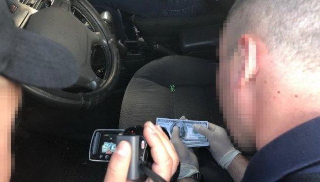 На хабарі спіймали керівника одного з райвідділів поліції Дніпропетровщини