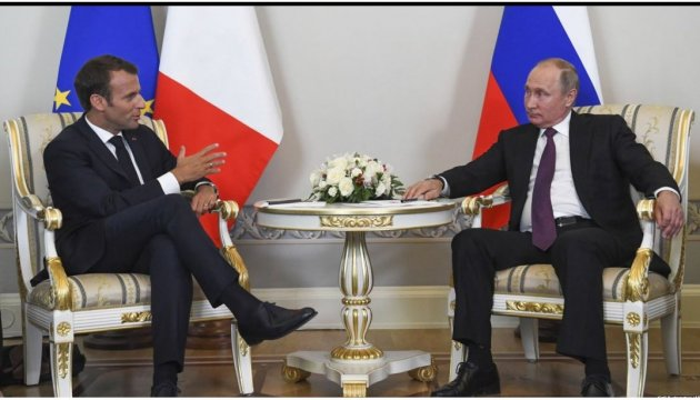 Macron, Putin discuss Minsk agreements implementation, release of Sentsov