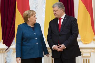 默克尔表示与波罗申科友好合作