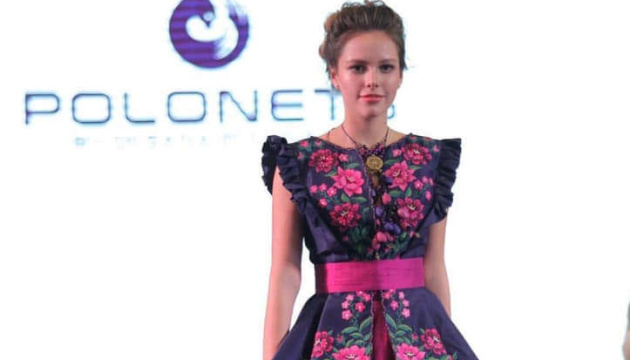 Ukrainian designer demonstrates embroidered dresses at fashion show in Bangkok. Photos