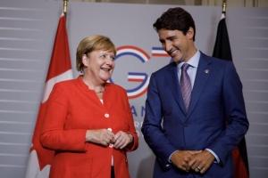 Трюдо та Меркель закликають Україну до реформ
