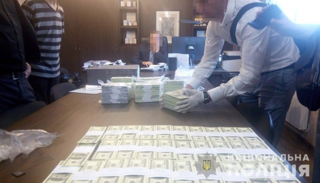 Two officials caught red-handed receiving $1.5 mln bribe