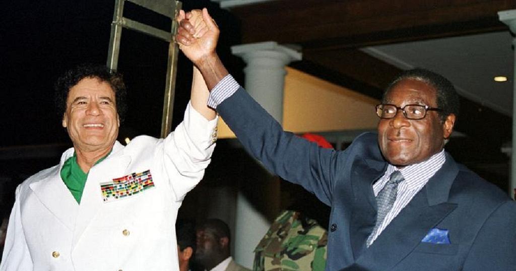 Муаммар Каддафі та Роберт Мугабе