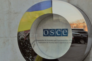 OSCE observers cross through road inside disengagement area near Zolote