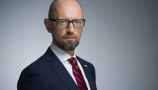 Yatsenyuk wins two court cases on