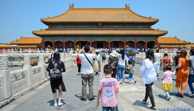В Китае отменили штрафы за рождение третьего ребенка