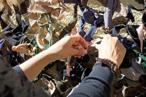 С начала войны на Донбассе в Каменском сплели 15 километров маскировочных сеток