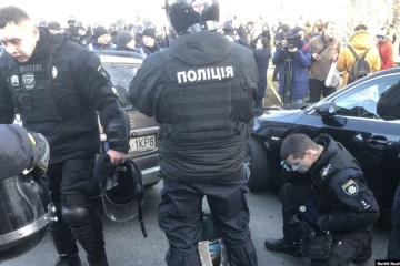 Protesters clash with police in Kyiv's government quarter