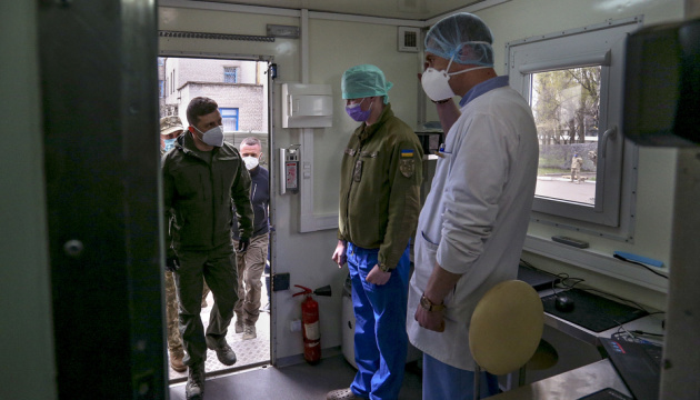 Zelensky visits tent camp of military field hospital in Donetsk region