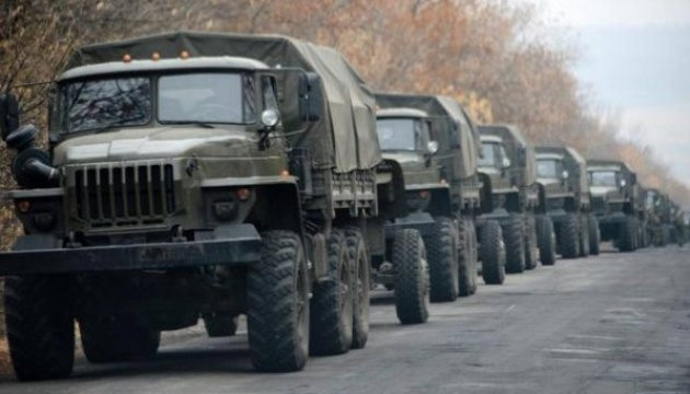 Russia delivers dozens of trucks with ammunition, armored vehicles to Donbas
