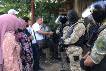 Seven Crimean Tatars detained after searches in occupied Crimea