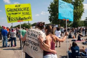 У Німеччині та Іспанії - протести проти карантину
