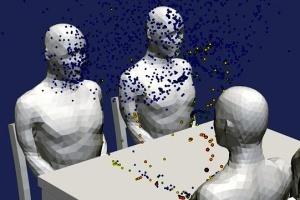 Вчені показали, як поширюється Covid-19 при розмові за столом