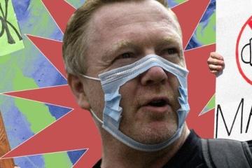 Вакцинованим американцям дозволили не носити маски