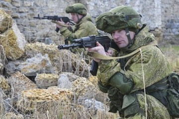 Russian units, which fought in Ossetia and eastern Ukraine, redeployed to Crimea